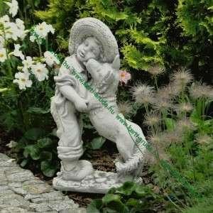 Fiú kutyussal kerti szobrocska