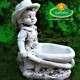 Kisfiú talicskával kerti szobor