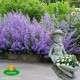 talicskás kerti szobor