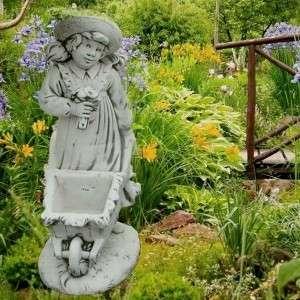 Különleges kerti virágtartó kislány talicskával